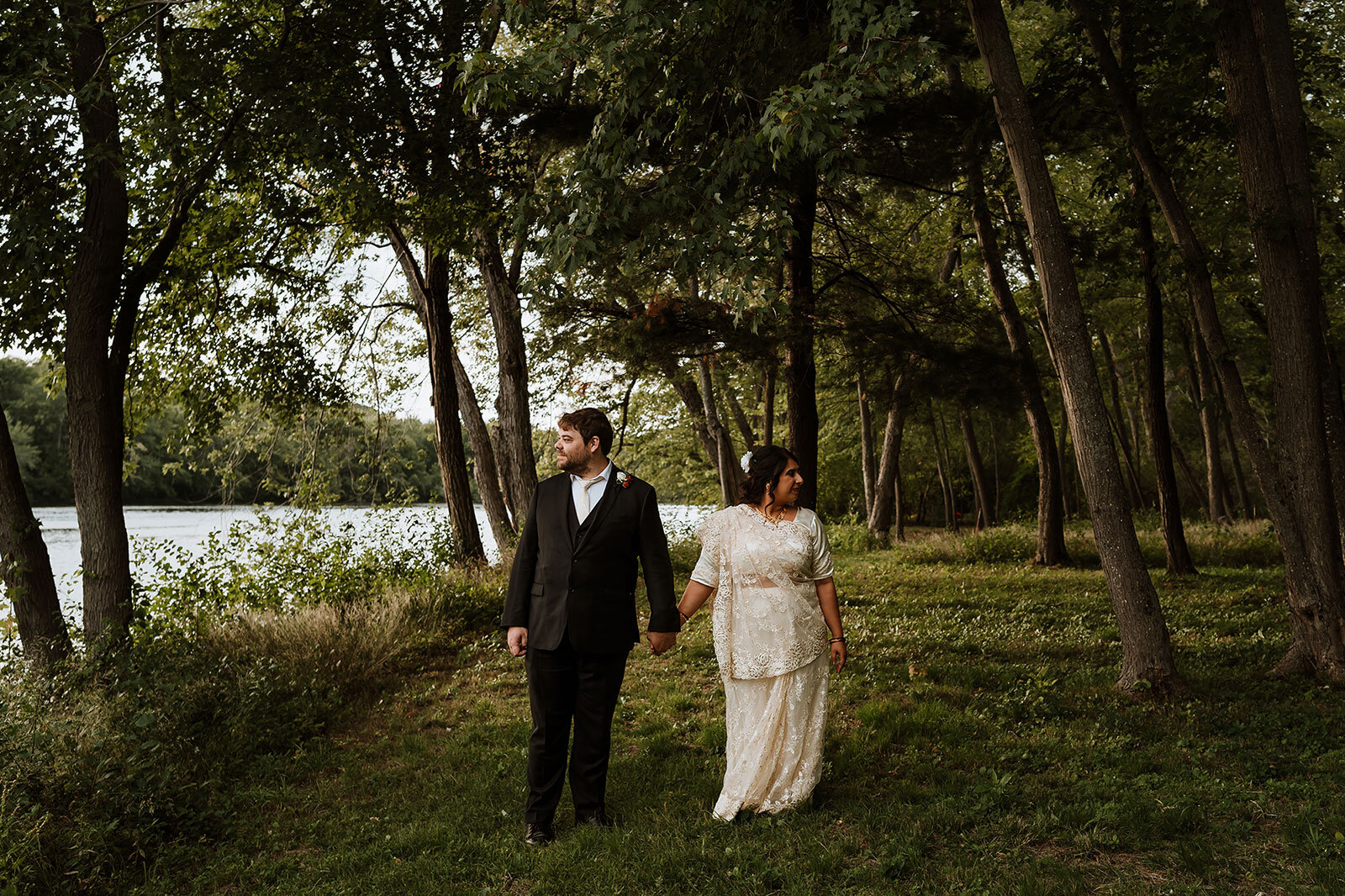 Newlywed couple hold hands under trees Rachel Epperly Film and Photo Portland Oregon