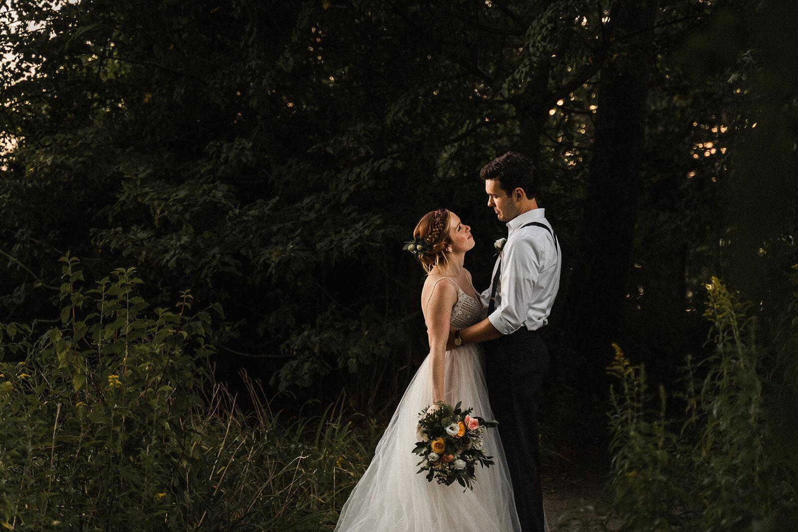 Newlyweds embrace under trees Rachel Epperly Film and Photo Portland Oregon