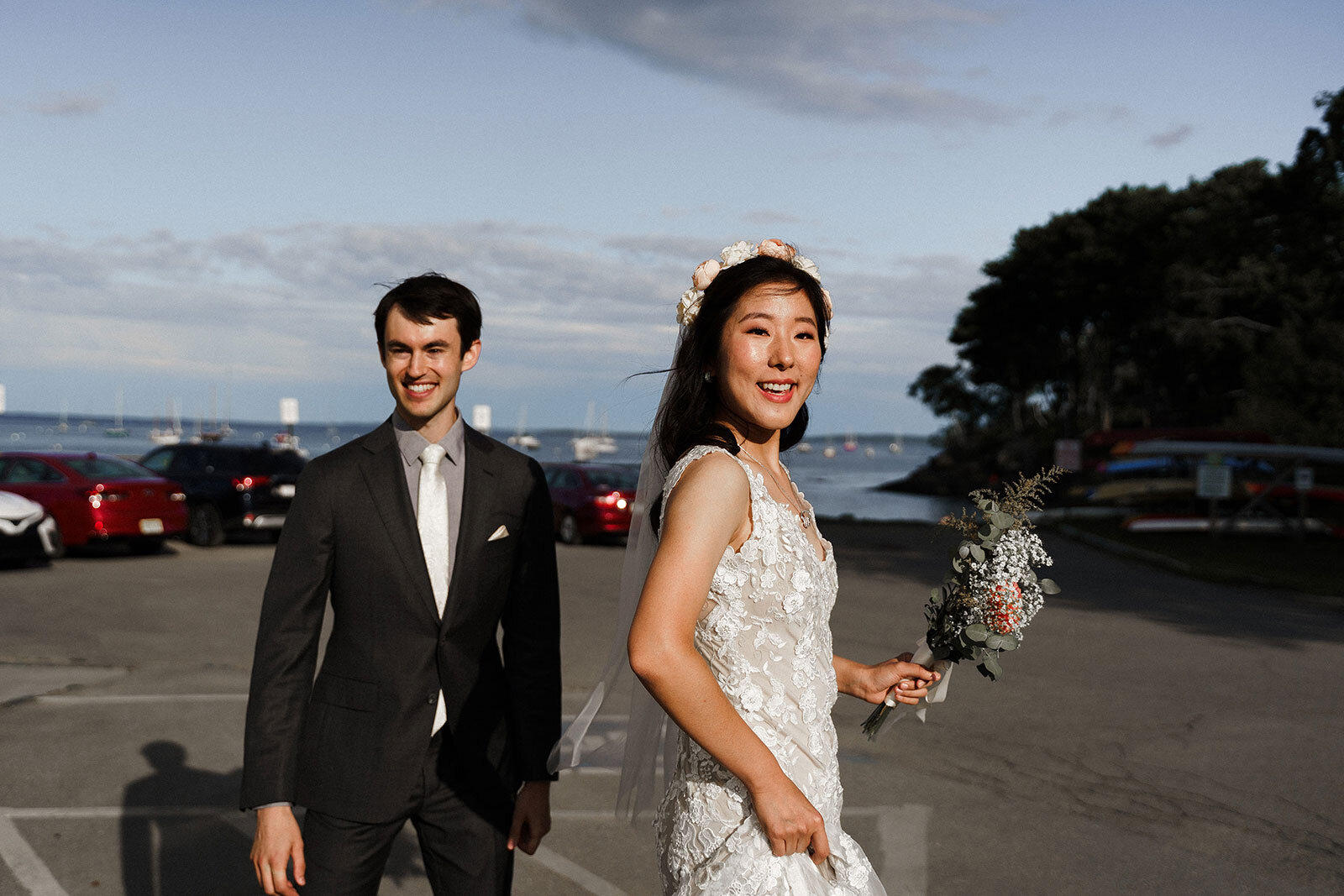 Newlywed couple smile in parking lot after ceremony Rachel Epperly Film and Photo Portland Oregon
