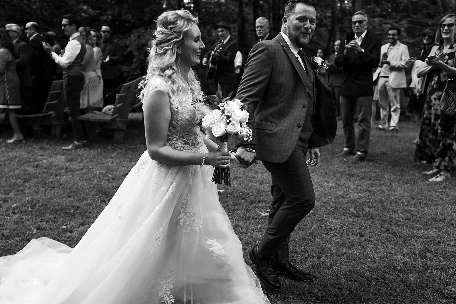 Newlywed walk hand in hand through the trees Rachel Epperly Film and Photo Portland Oregon