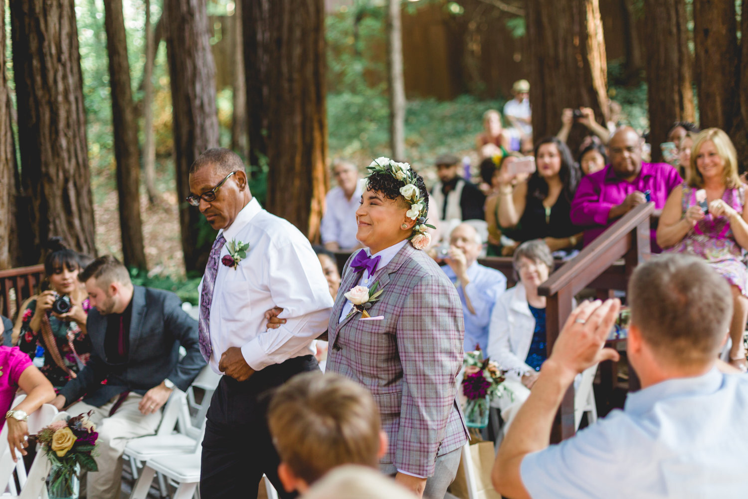 roz walking into wedding ceremony at redwoods sanctuary in California