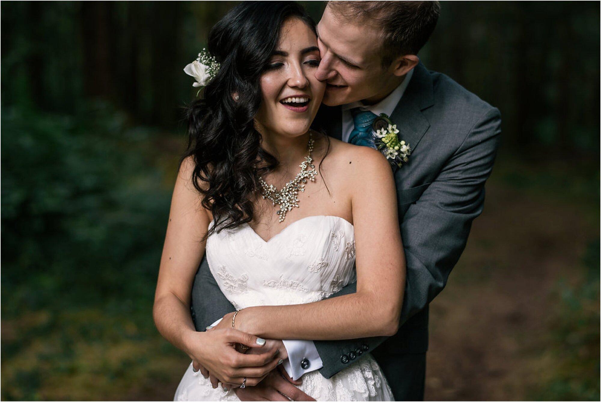 Newlyweds embrace after wedding ceremony at campsite in Northwest Washington state