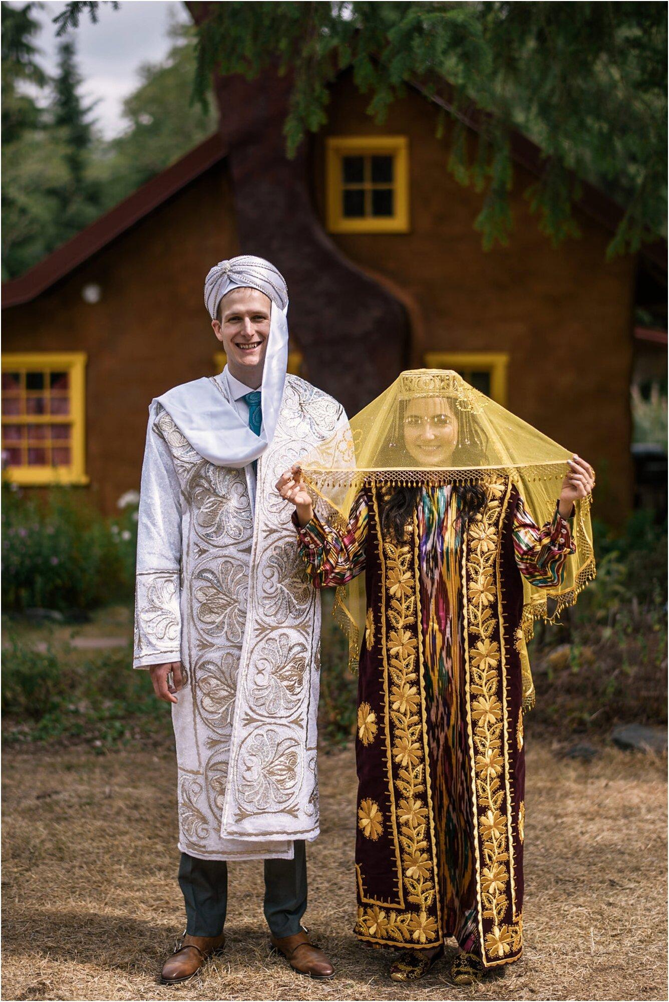 Portrait of Alex and Nodira in their traditional Uzbek wedding attire during their campsite wedding in Washington state
