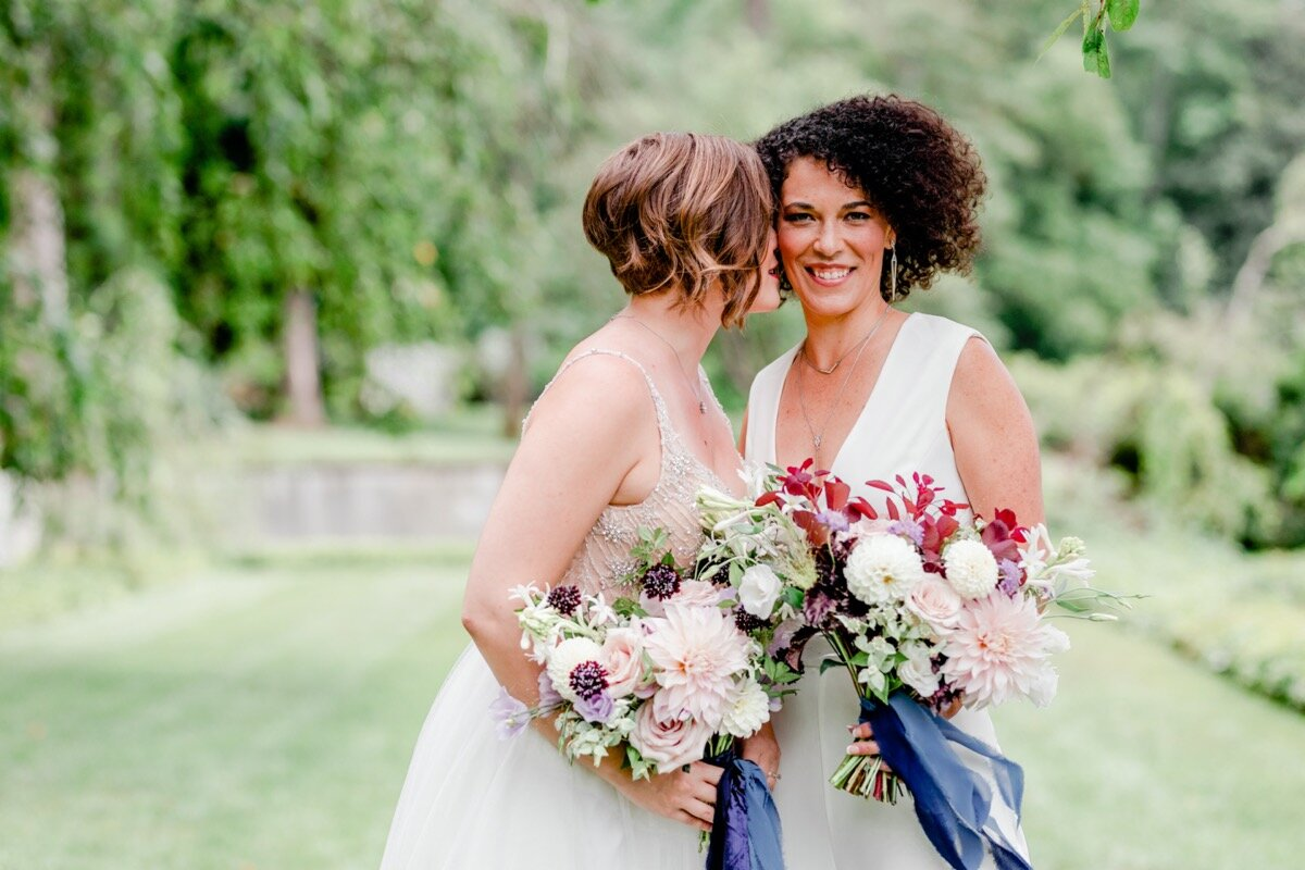 Celestial and Geode wedding inspiration in Winston Salem NC showing two brides in wedding dresses with bouquets Ariel Kaitlin Photography