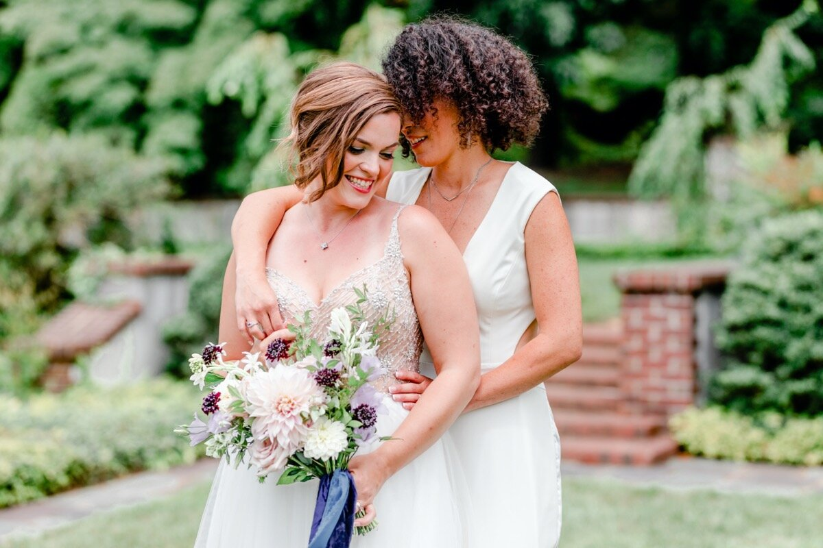 Celestial and Geode wedding inspiration in Winston Salem NC showing two brides in wedding dress and jumpsuit with bouquets Ariel Kaitlin Photography
