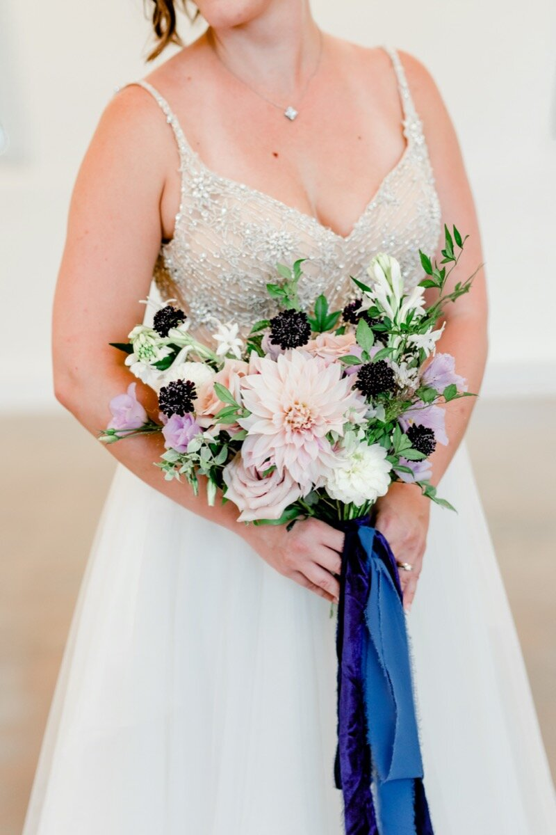 Celestial and Geode wedding inspiration in Winston Salem NC showing bride in wedding dress holding bouquet Ariel Kaitlin Photography