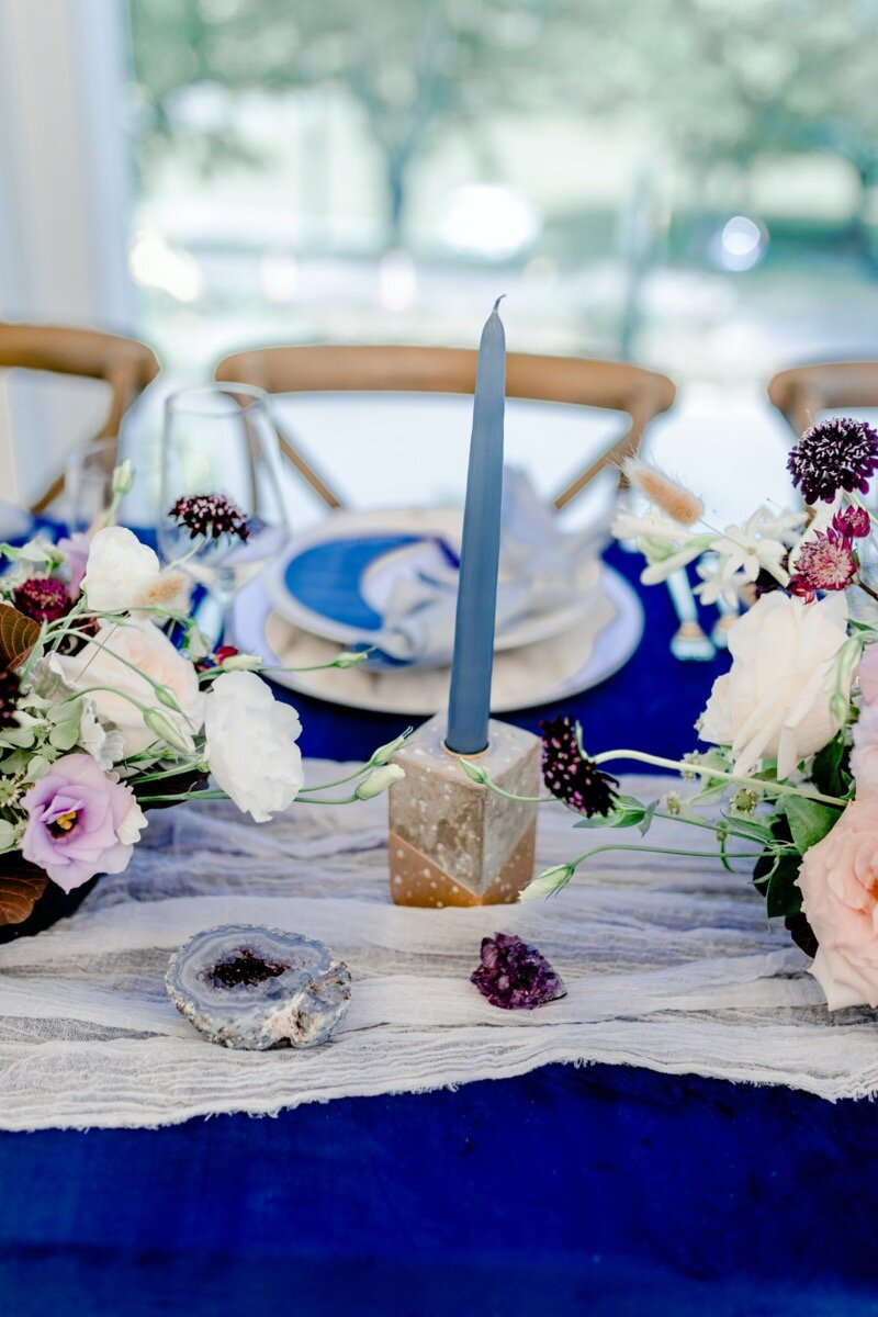 Celestial and Geode wedding inspiration in Winston Salem NC showing cobalt blue and gold table setting Ariel Kaitlin Photography