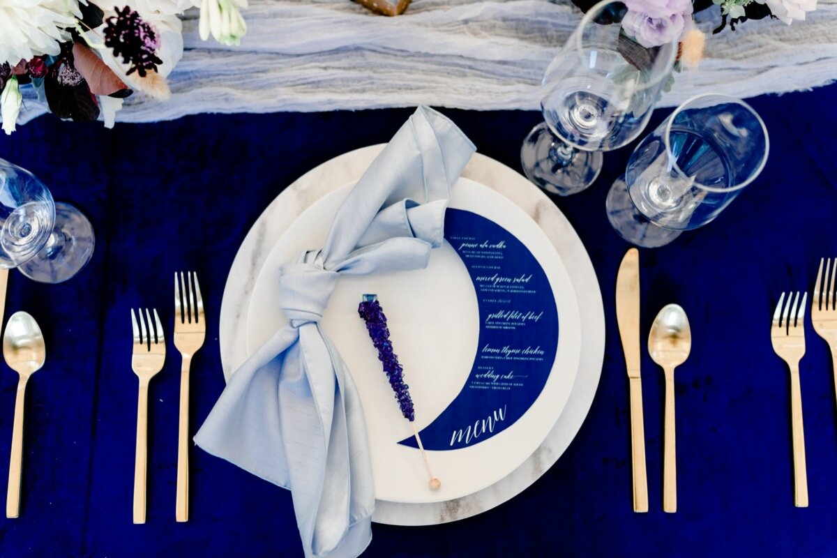 Celestial and Geode wedding inspiration in Winston Salem NC showing cobalt blue and gold moon menu and table setting Ariel Kaitlin Photography