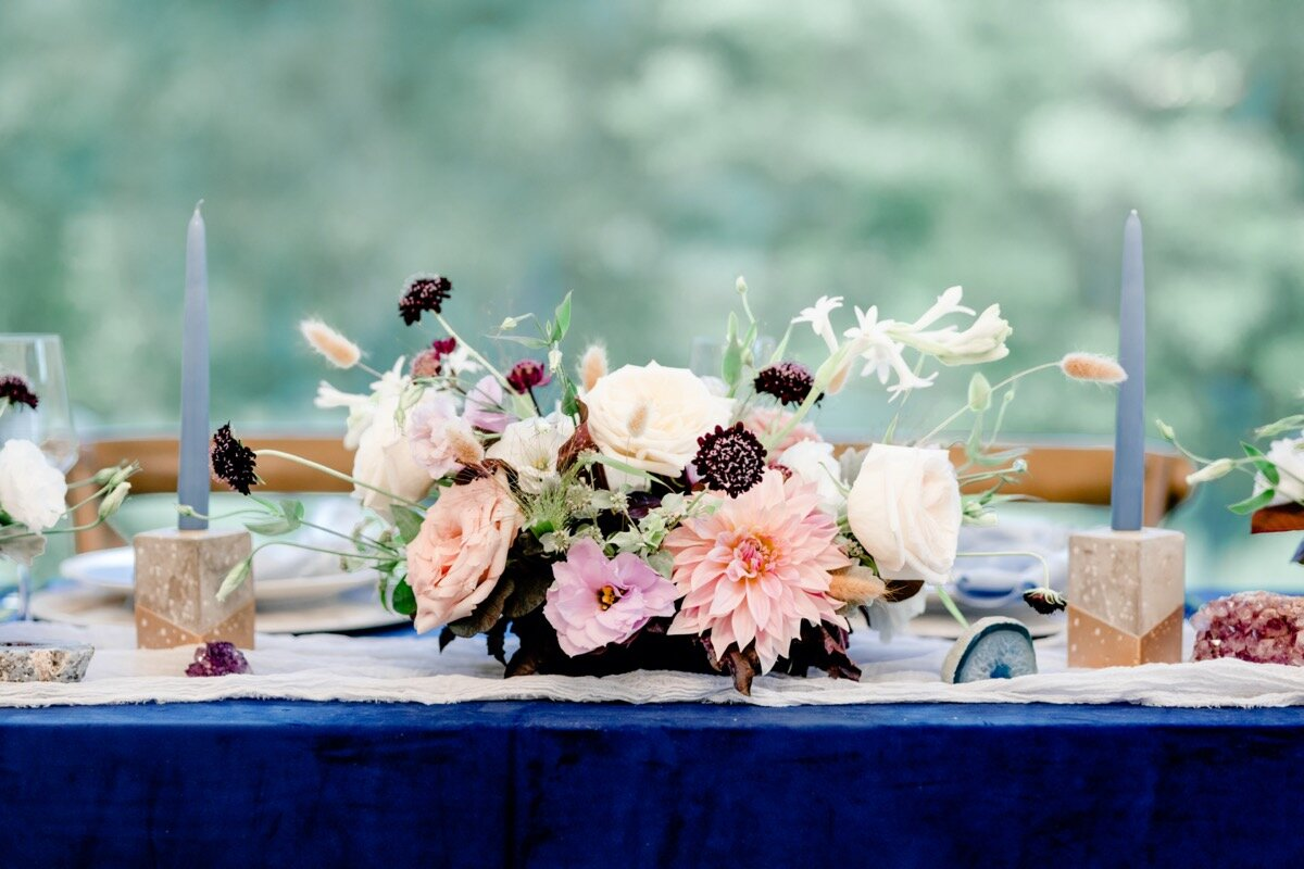 Celestial and Geode wedding inspiration in Winston Salem NC showing floral centerpiece on blue purple and gold head reception table Ariel Kaitlin Photography