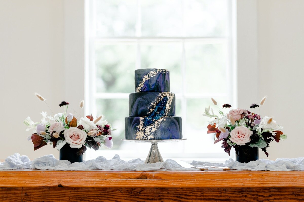 Celestial and Geode wedding inspiration in Winston Salem NC showing geode blue and gold wedding cake on reception table Ariel Kaitlin Photography