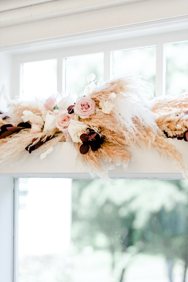 Celestial and Geode wedding inspiration in Winston Salem NC showing autumnal floral arrangement above barn door Ariel Kaitlin Photography