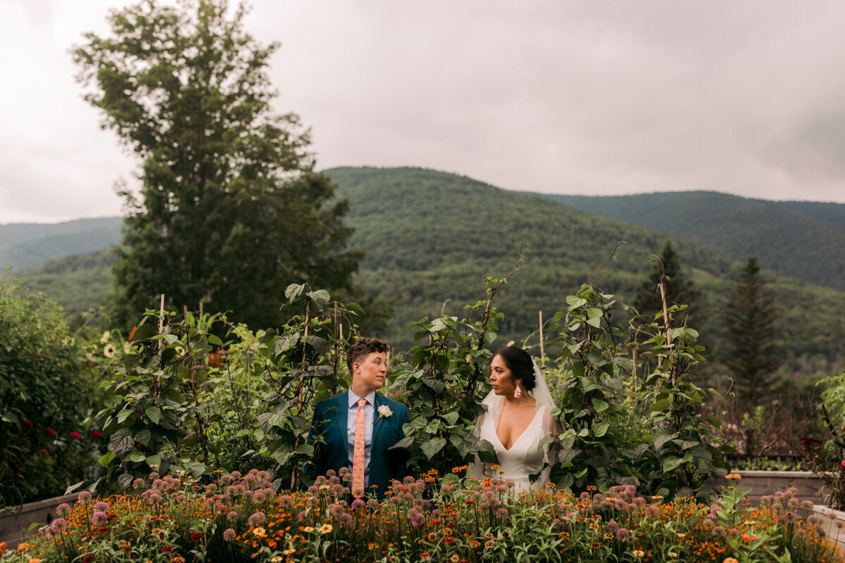 newlywed couple gazes at each other amongst garden plants and flowers during catskills new york styled shoot Carly Romeo & Co.