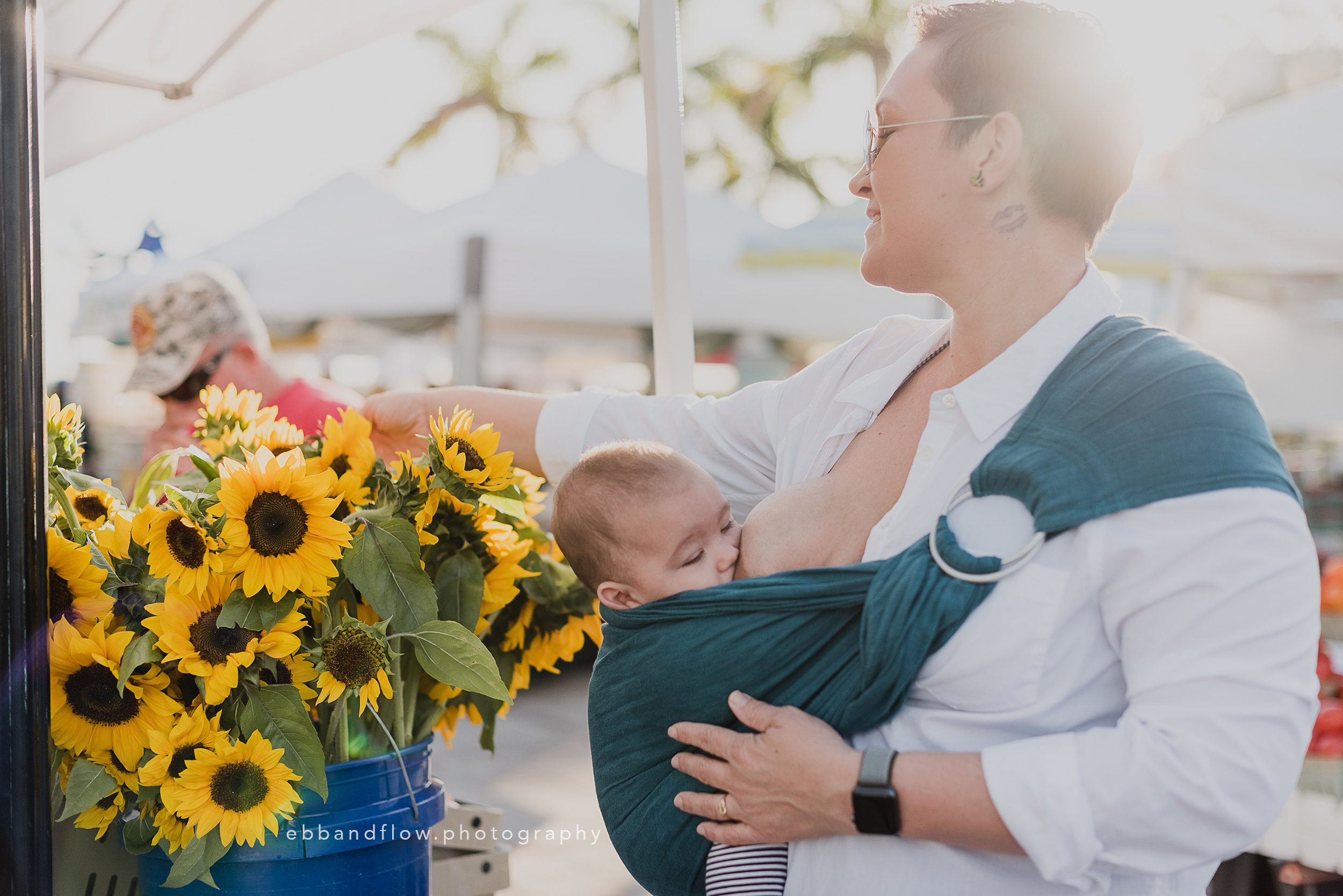 Fort Pierce Breastfeeding Photography - Ebb and Flow Photography -  Ring Sling shopping for flowers at the farmers market.jpg