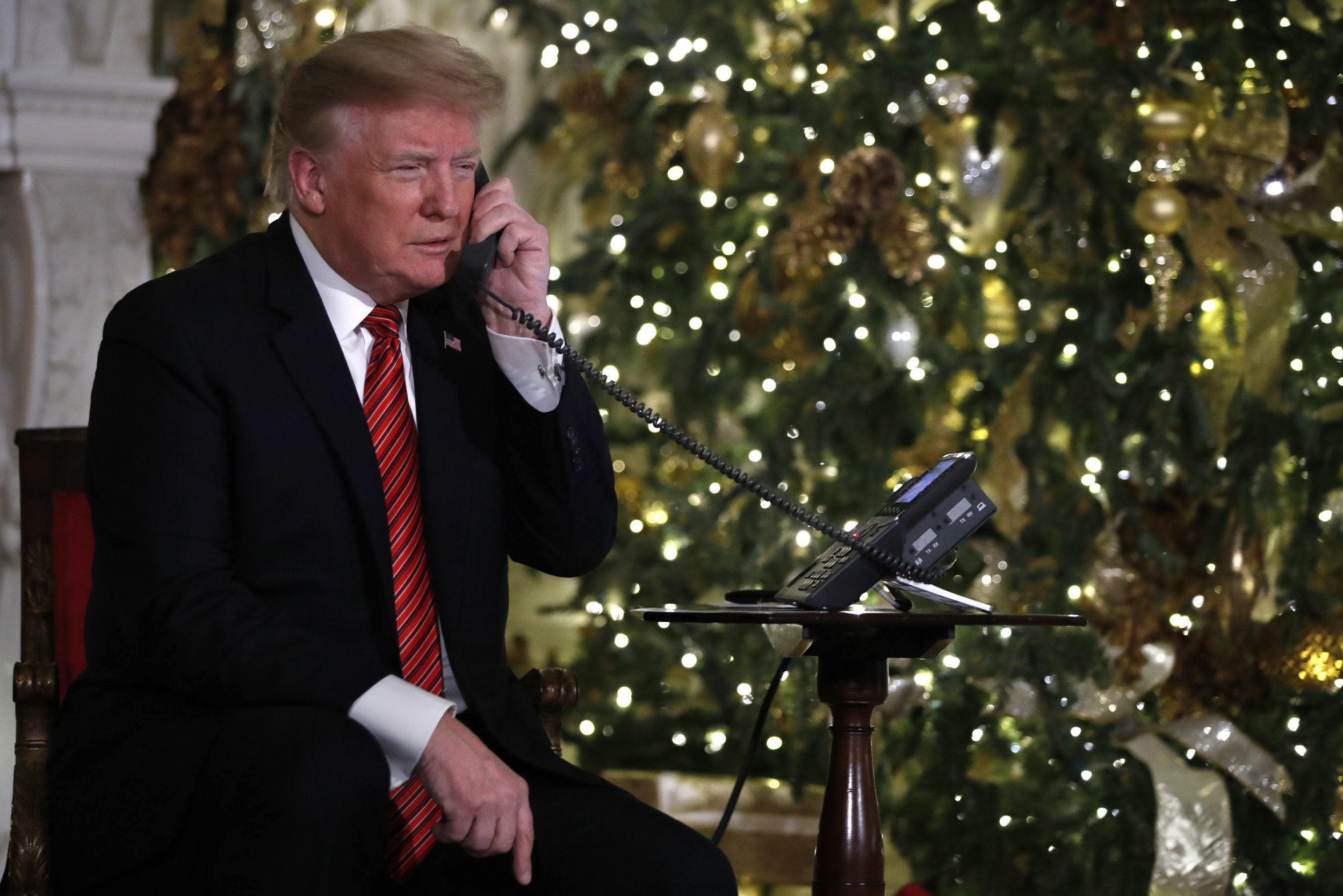 Trump in the White House, frightening children calling the NORAD Santa Tracker hotline, Christmas Eve, Monday, Dec. 24, 2018. (AP Photo/Jacquelyn Martin)