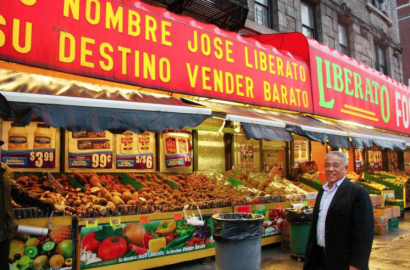 Jose Liberato, in front of his grocery store in NYC   Photo: Camila Osorio