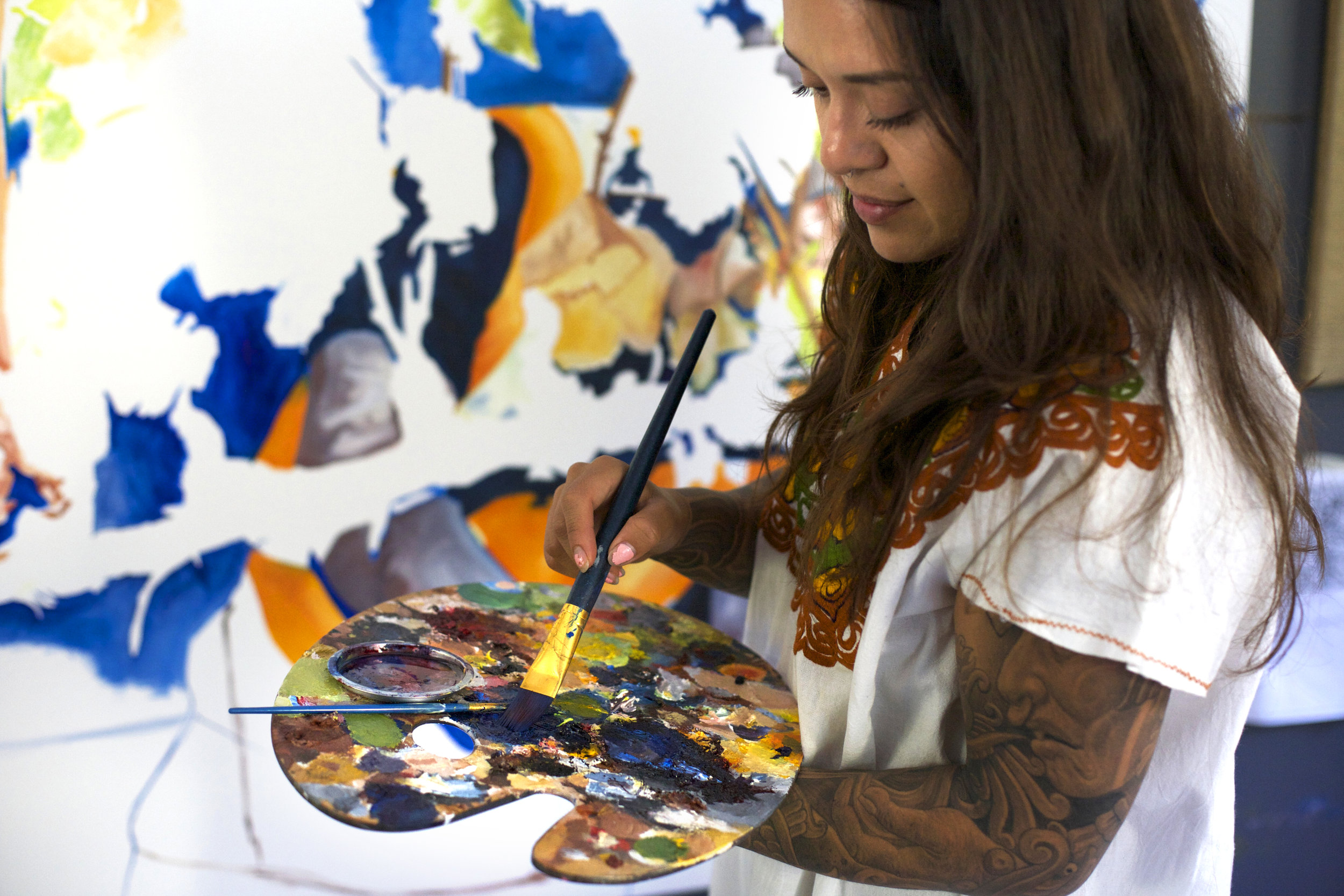 Arleene Correa Valencia works on a painting in her latest series:  In Times of Crisis, En Tiempo de Crisis.    Rachael Bongiorno for NPR