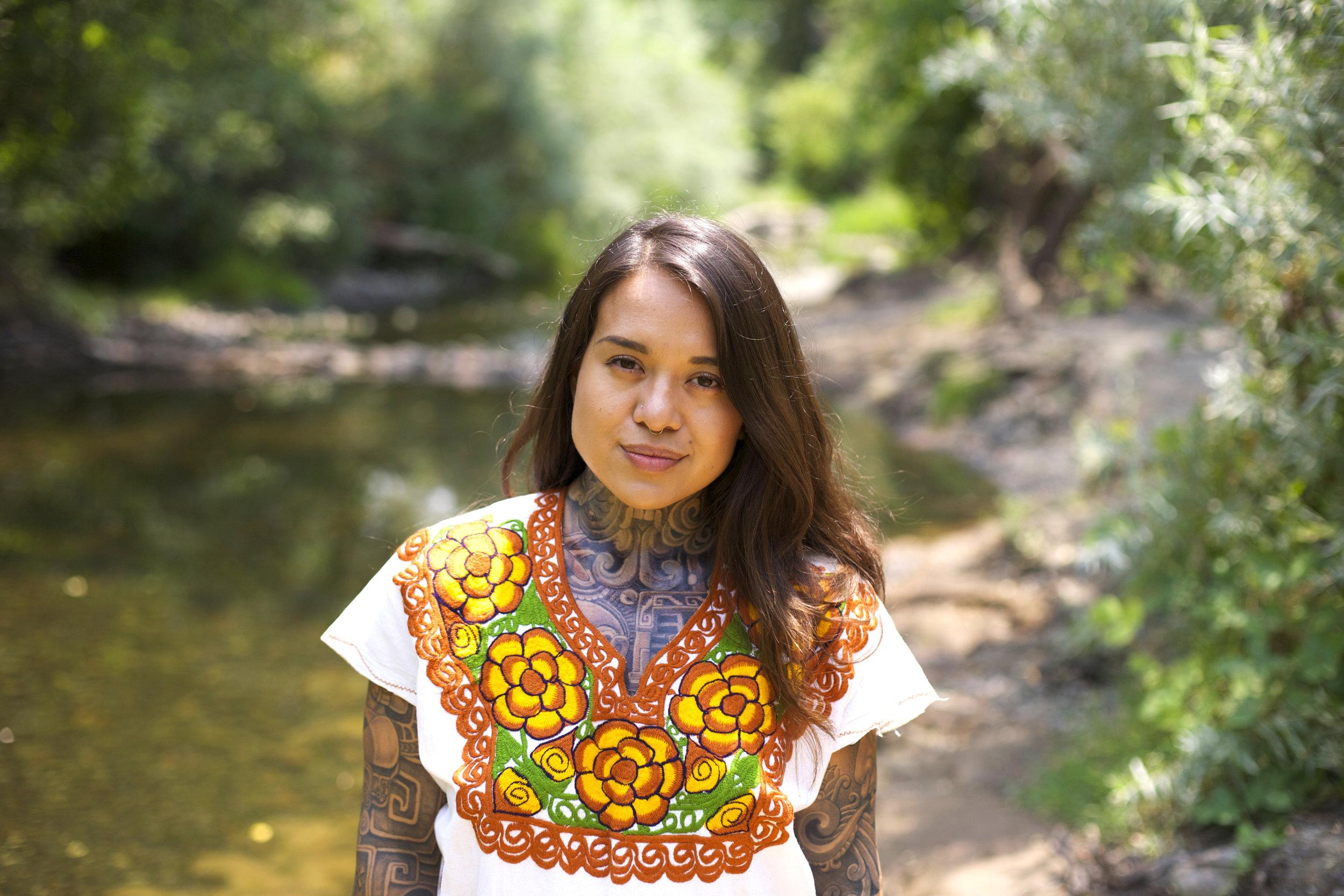 Arleene Correa Valencia stands by the creek on the Silverado Trail in Napa Valley.   Rachael Bongiorno for NPR