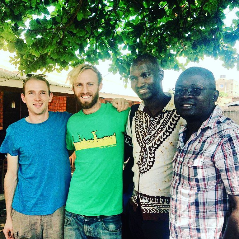 Chris, Mark, Joshua & Francis discussing our programs in Uganda