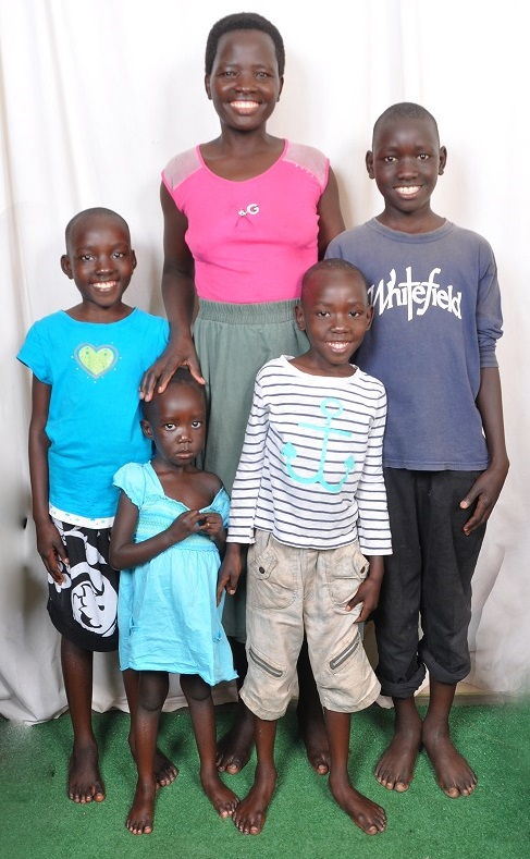 Michelle, her mother, and some of her siblings