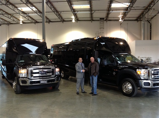 Grech Motors CEO Ed Grech with Michael S. Kusher, VP of Wilshire Limousine Services. Wilshire added GM33 luxury shuttle buses to their high-end Los Angeles fleet.