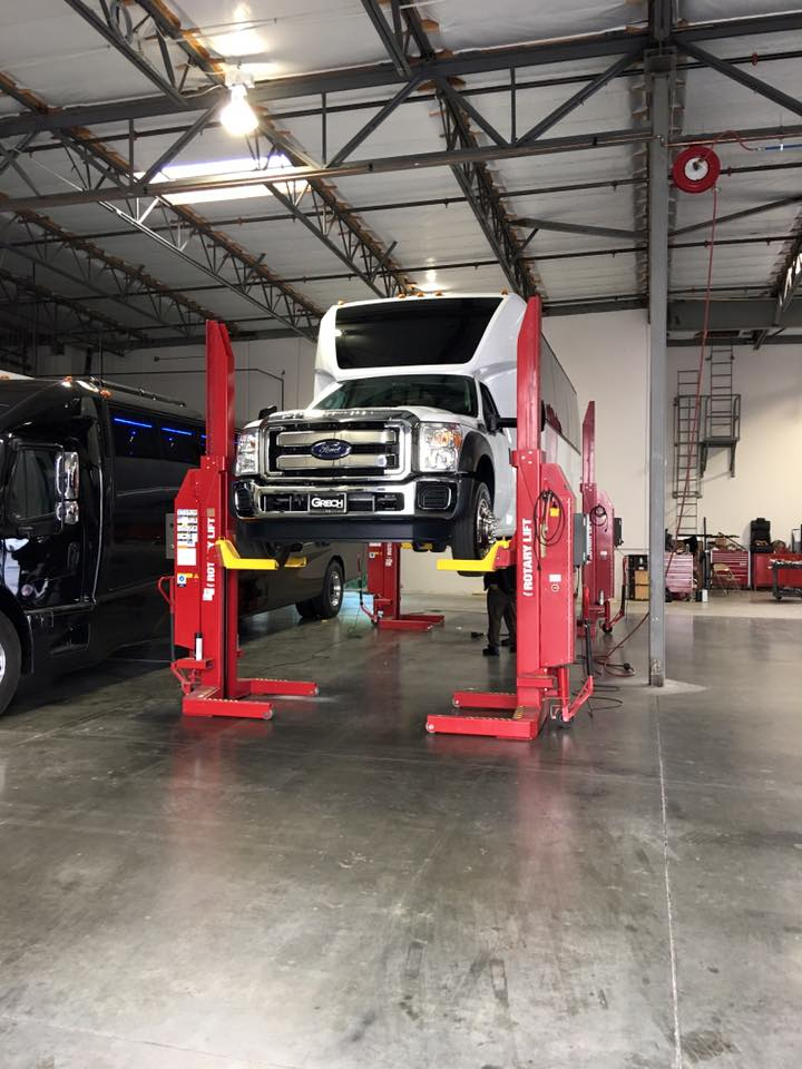 Grech Motors F-550 GM33 on a bus lift undergoing quality control checks and maintenance.