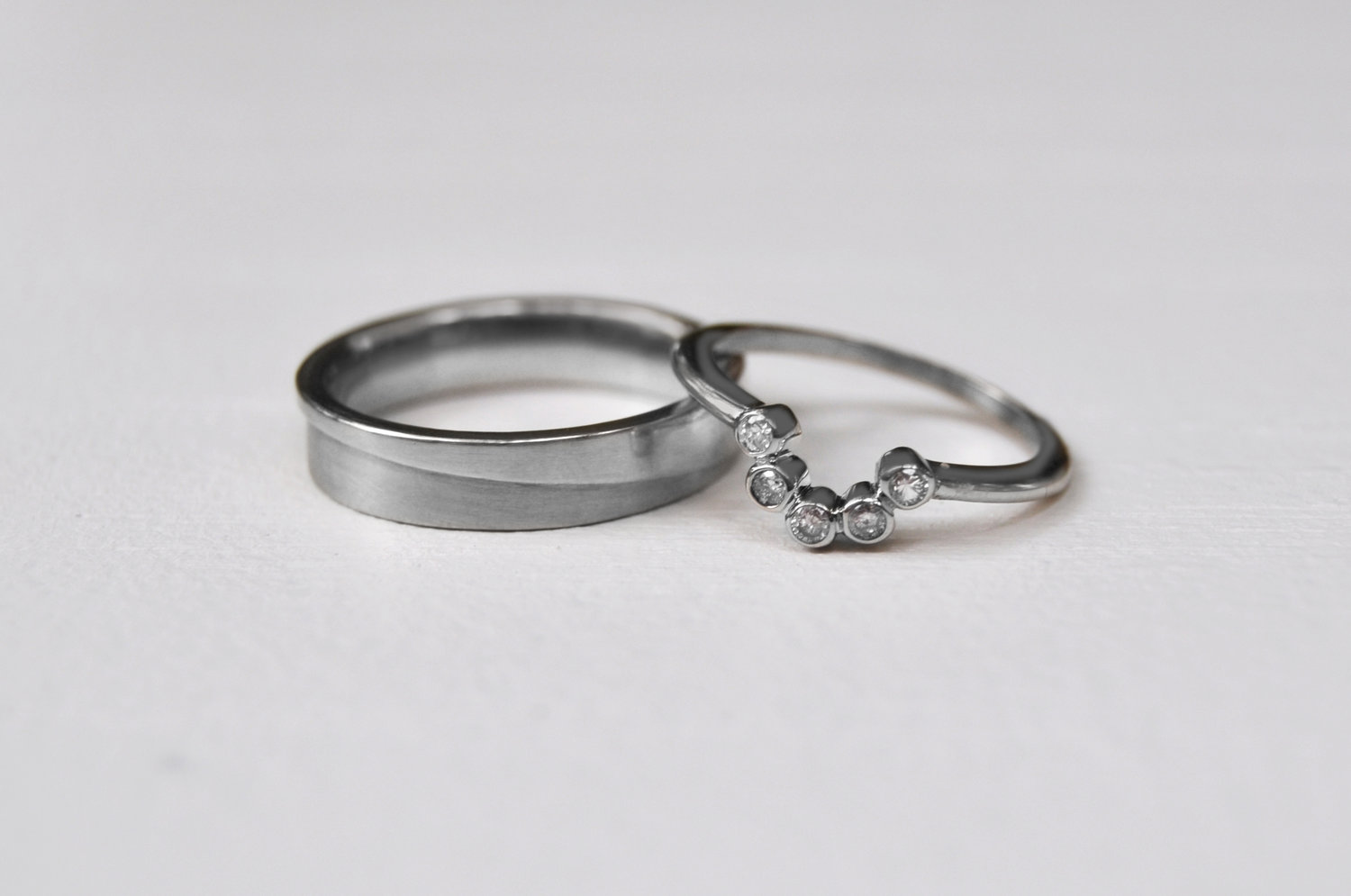 White gold and diamond wedding bands for Maryam and Jared