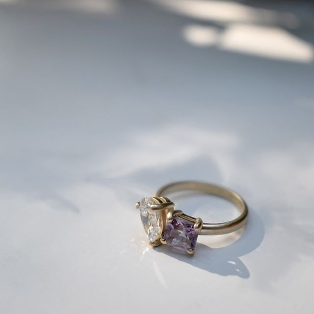 Custom work for M + J  with an heirloom diamond pear shaped diamond and a custom princess cut Rose de France colored Amethyst. All set in satin finished yellow gold.