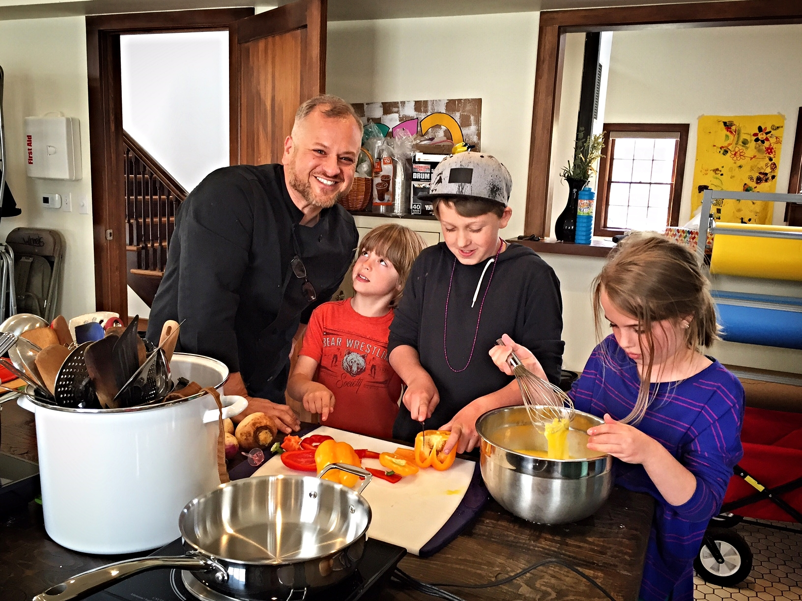 Scotty Irani, of  In the Kitchen with Scotty ,cooking with our 2016 Spring Break Urban Farm Campers. The campers created a full meal made with local, organic food for their parents on the last day of camp!