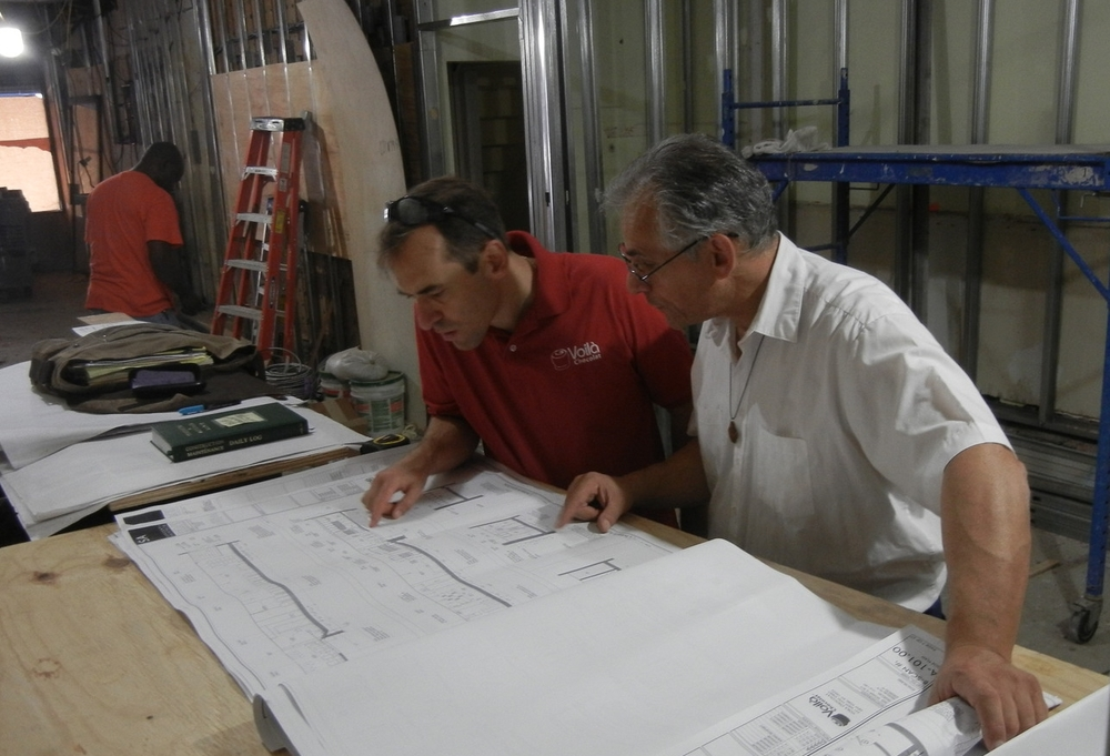 Consulting the plans for 221 West 79th Street.