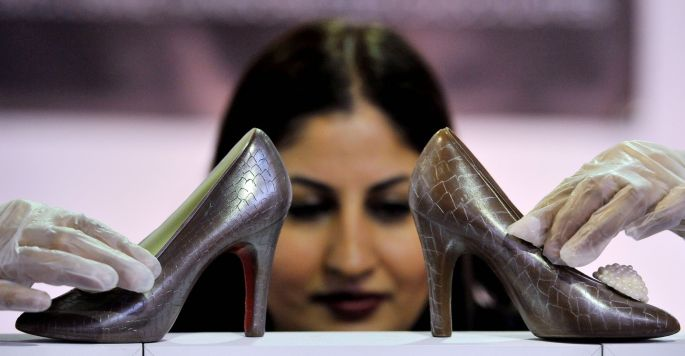 Azra Sadiq with her hand-crafted chocolate shoes. Photograph: Nick Ansell/PA Wire