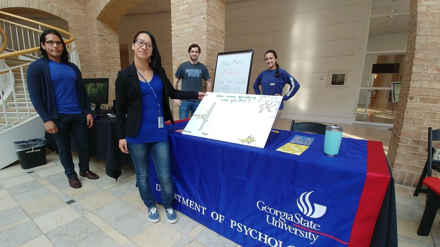 - Students Jhonatan Saldaña, Julia Watzek, Caleb Truscott, and Olivia Tomeo Reilly at the 2017 Fernbank Museum of Natural History's Adventures in Science day, in which families got to participate in our tasks and compare their performance to our non-human primate subjects.