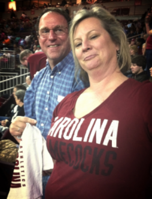 With friends Hugh and Ginger at the last home game for 2013-2014.