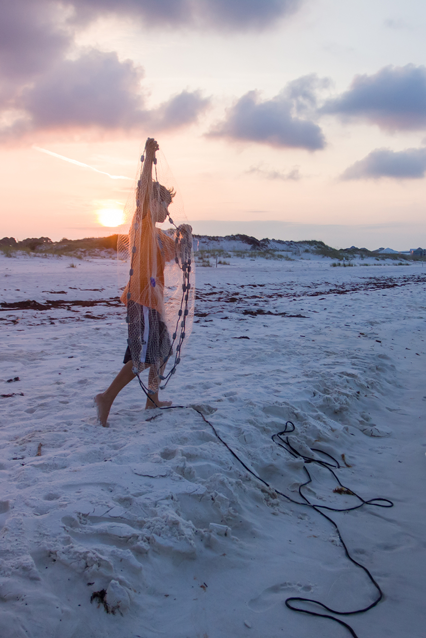 Hauling a casting net during sunrise.