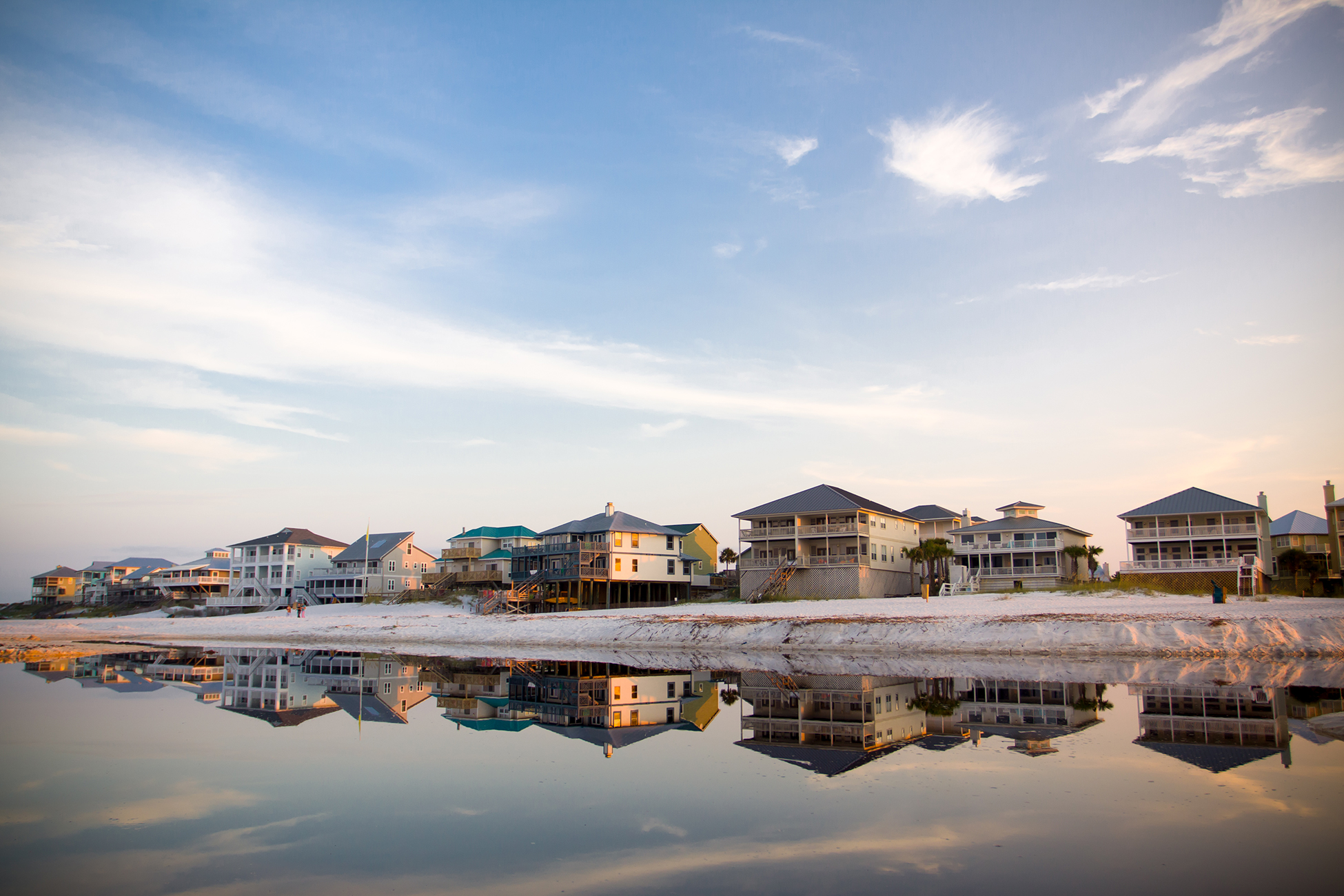 Beach houses reflected in the tide pool.
