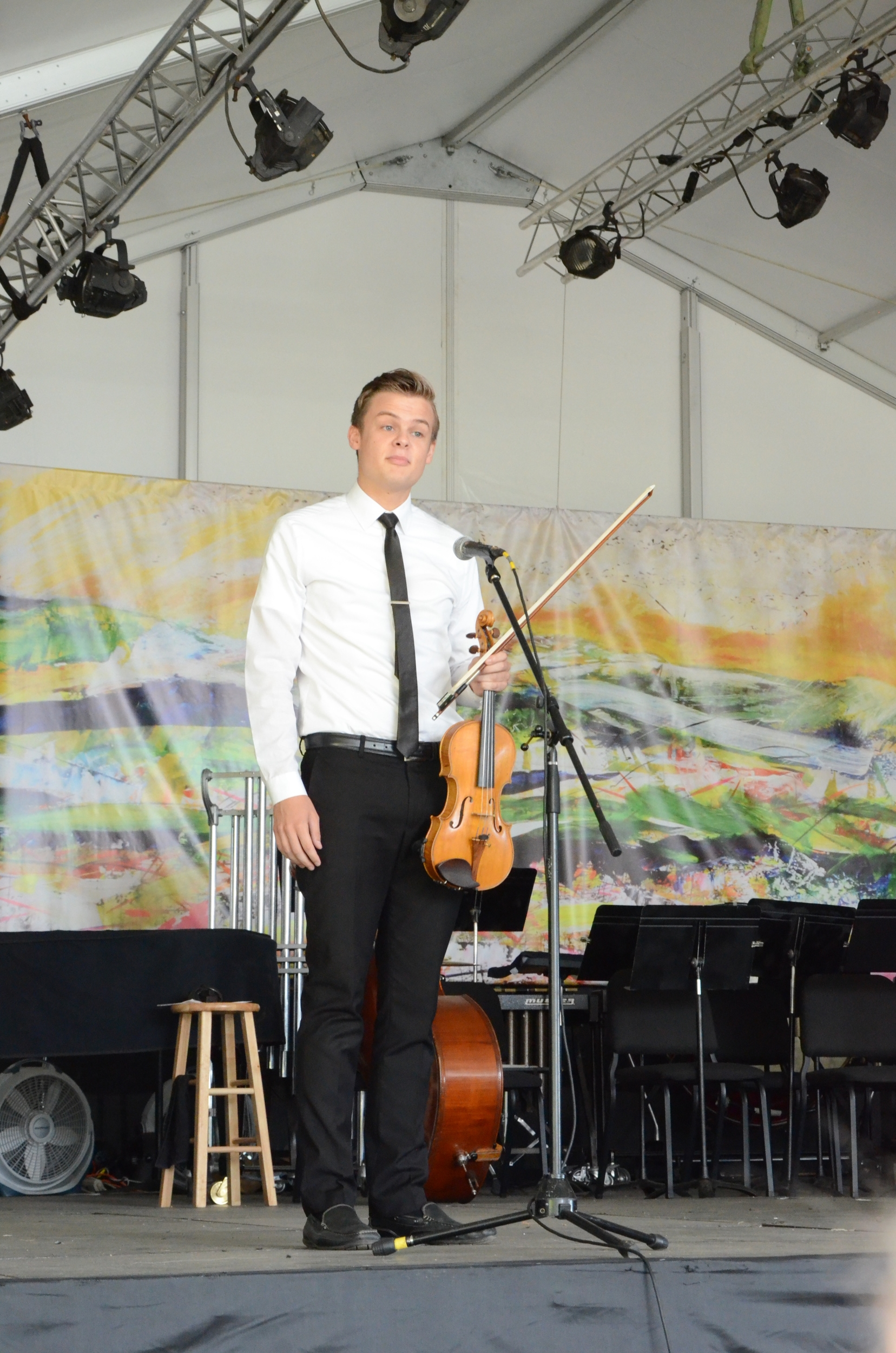 Academy student Walker Konkle introduces his quartet while standing in front of the backdrop.   Photo credit: John Taylor