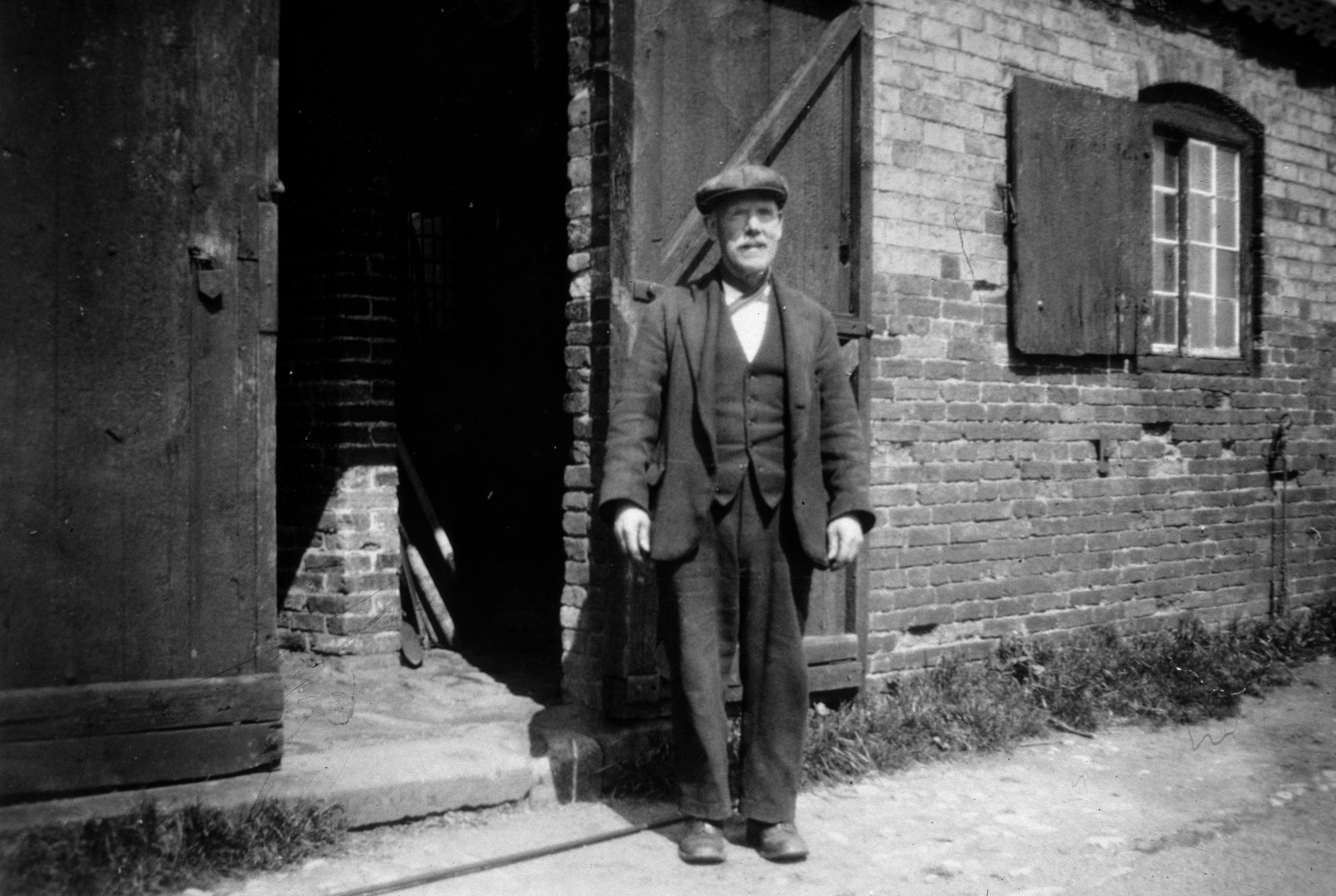Mr. Thompson - The Blacksmith whose shop was at the site of number 6 The green.