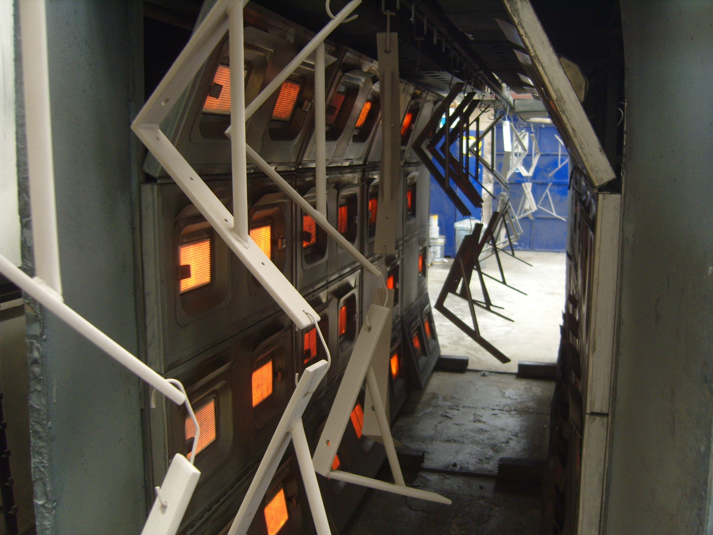 Powder coated components in curing oven.