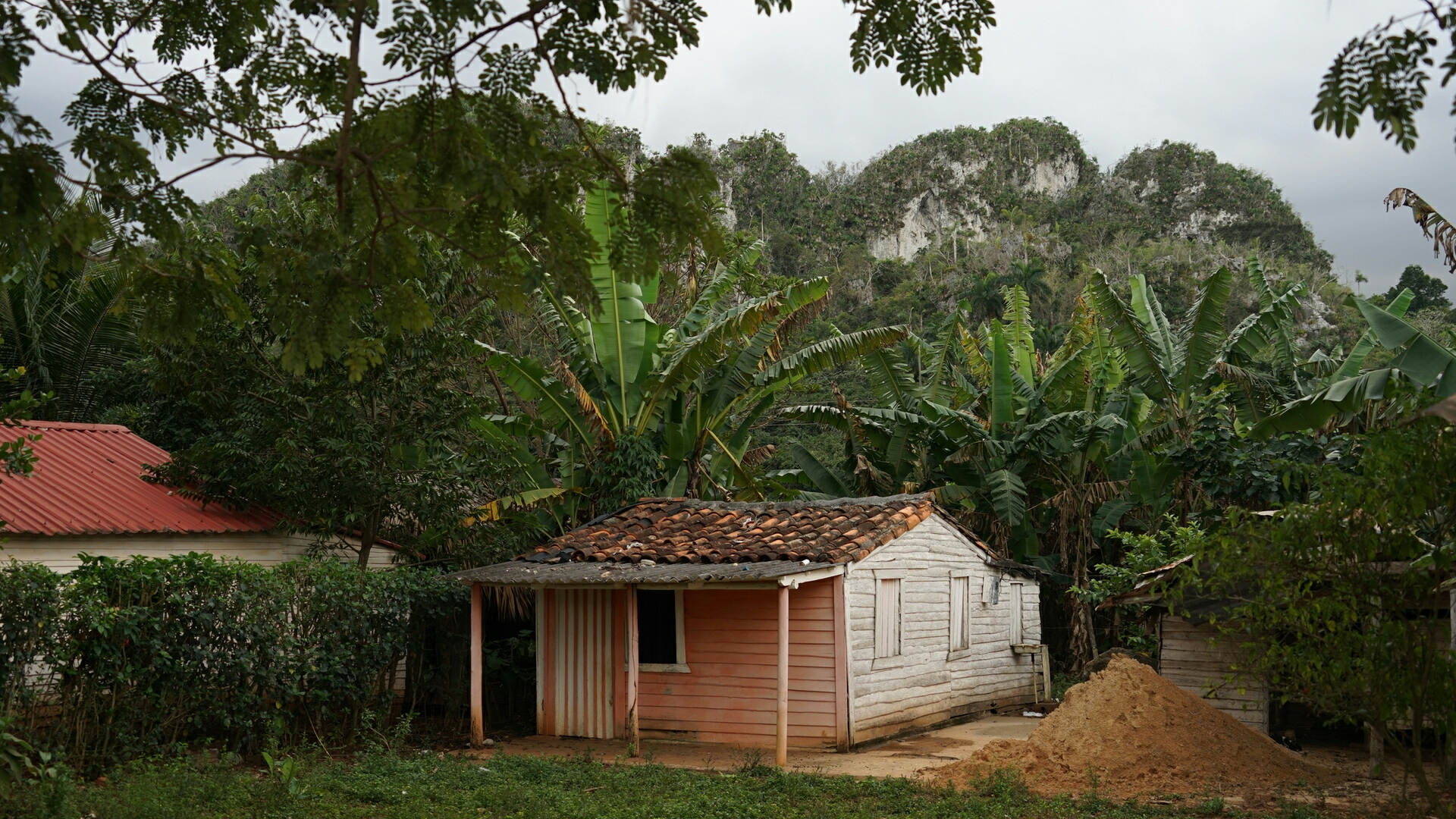 A home at the foothills of the  mogotes , mini mountains in the countryside of Vinales.