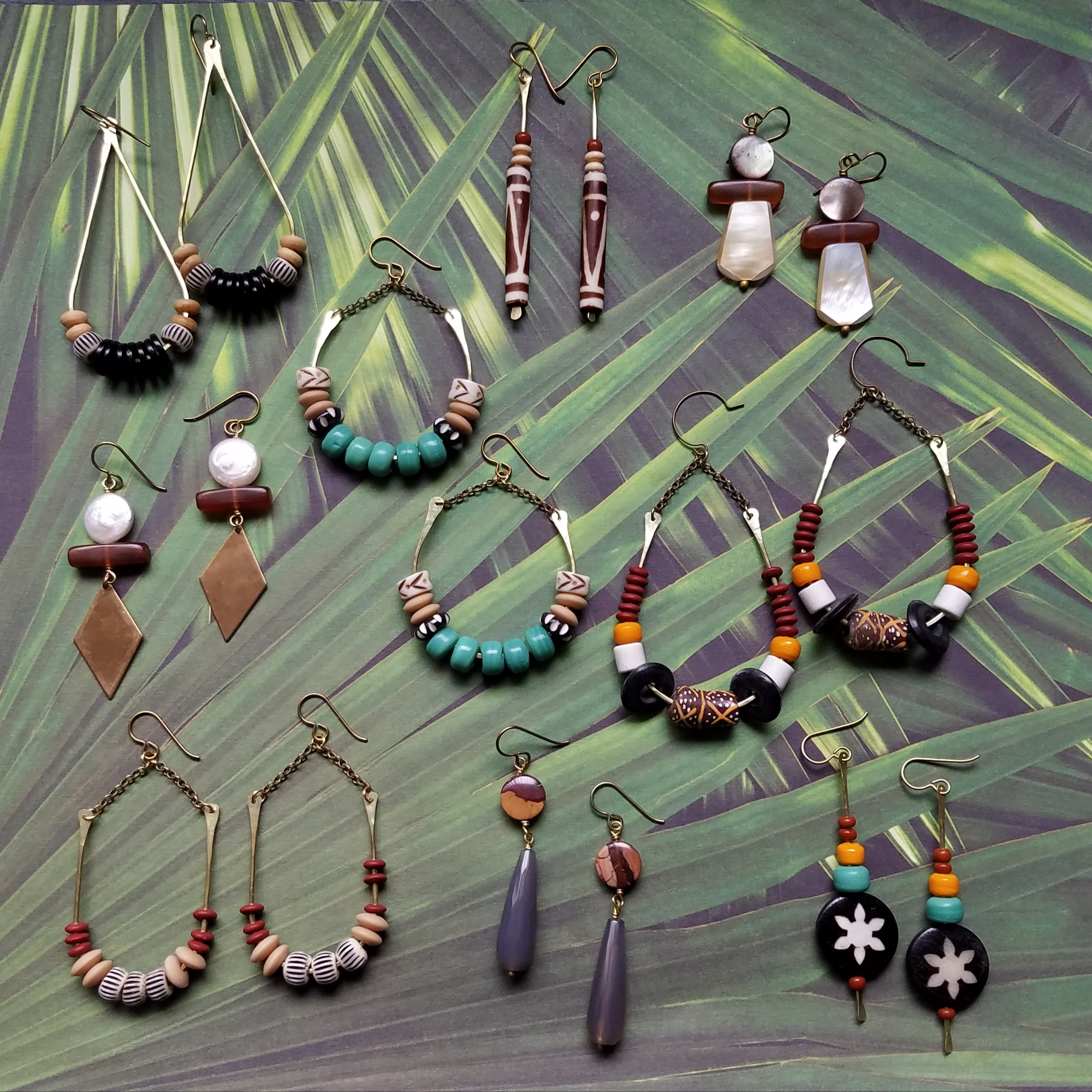 A bevy of beauties made with a combination of: shell, bone, gemstone, glass, and horn beads.