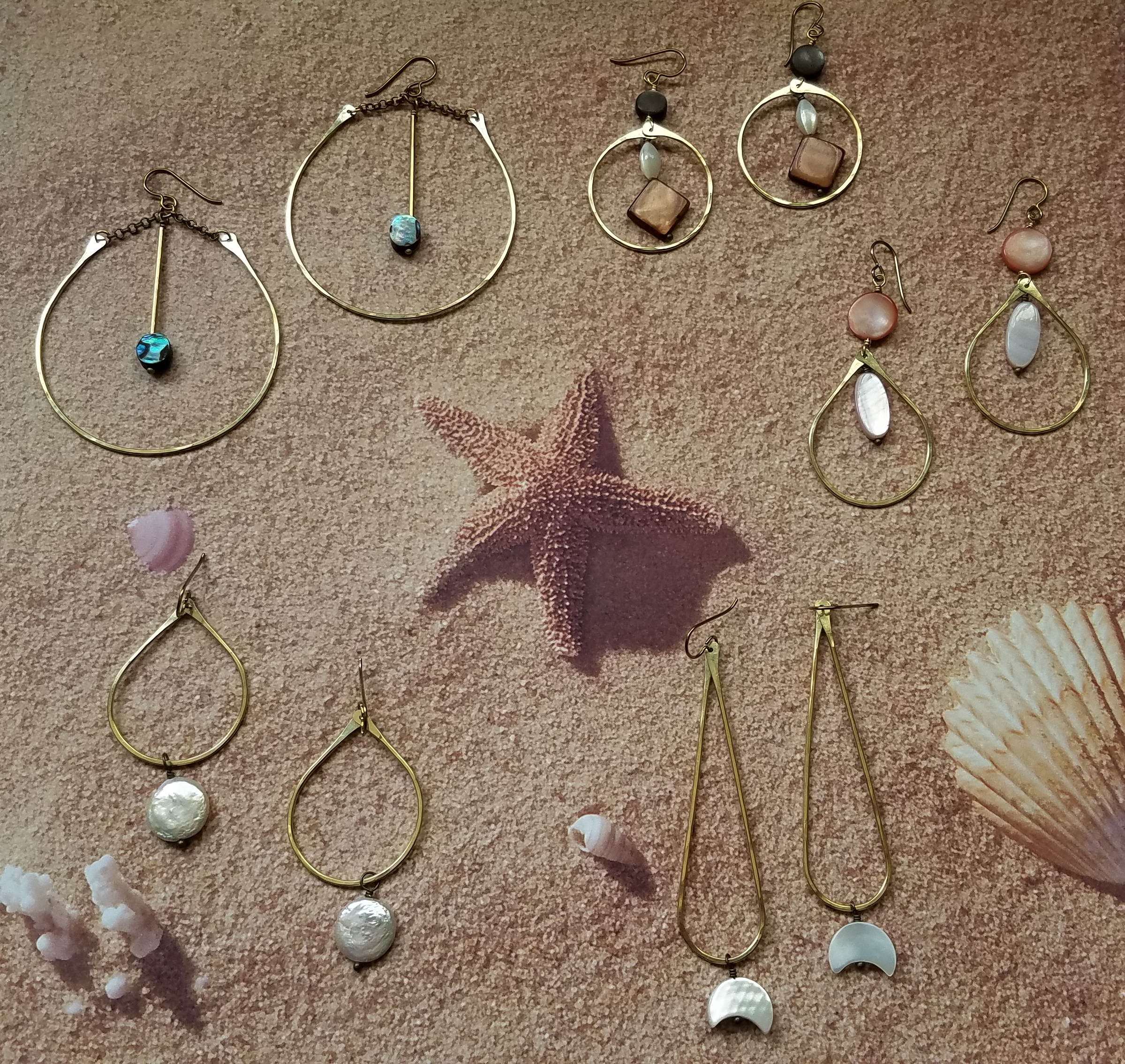 It may not be by the sea shore, but these seashell earrings will be for sale at the Market!
