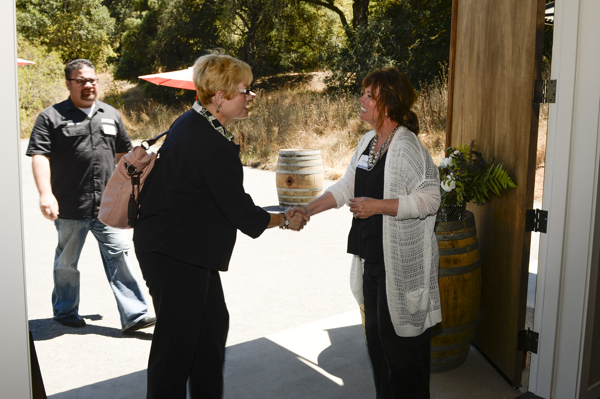 Whitney greeting guests at The Highlands Estate