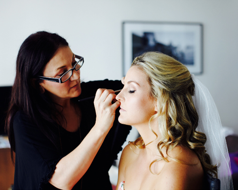 Julie Elton creating bridal makeup