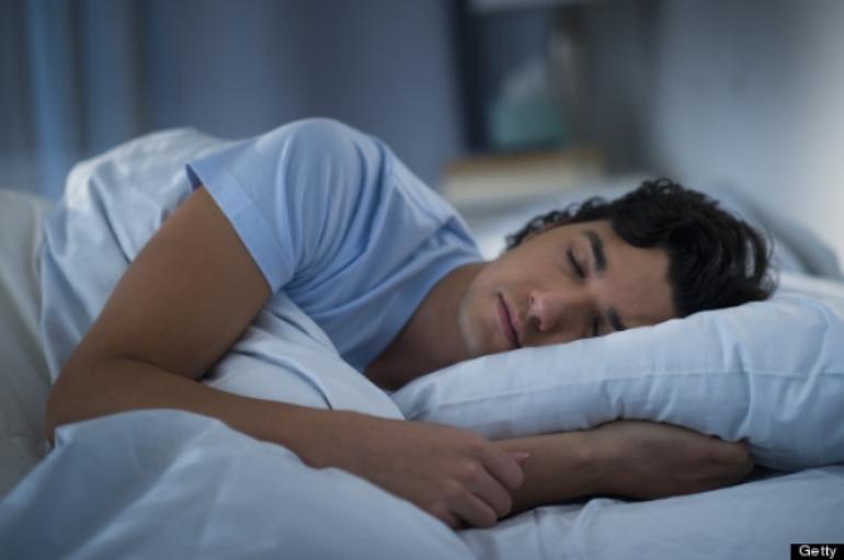 man sleeping blue shirt dark hair peaceful.jpg