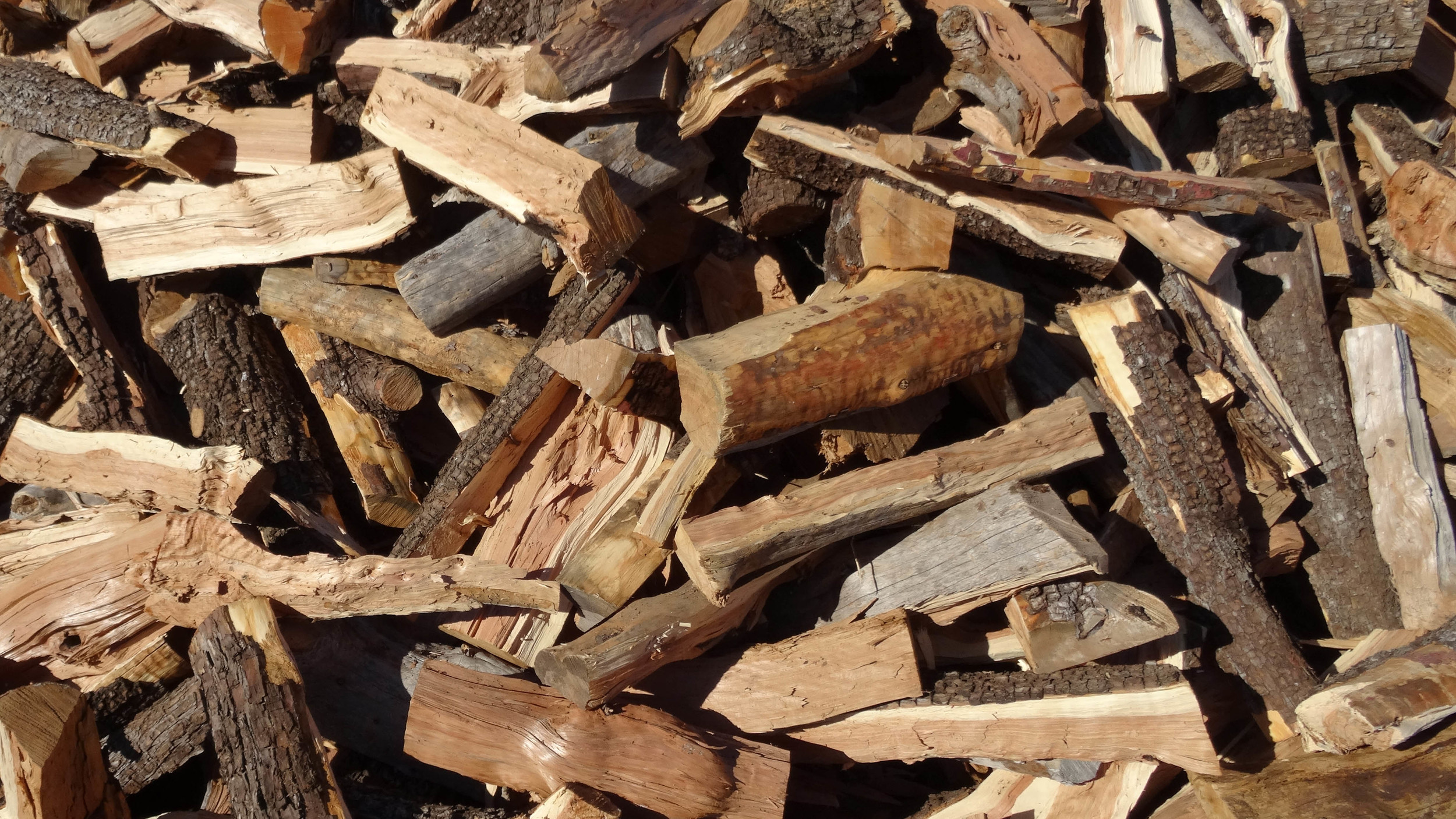 A medium hardwood. Great cedar-like aroma. Not a recommended cooking fuel.
