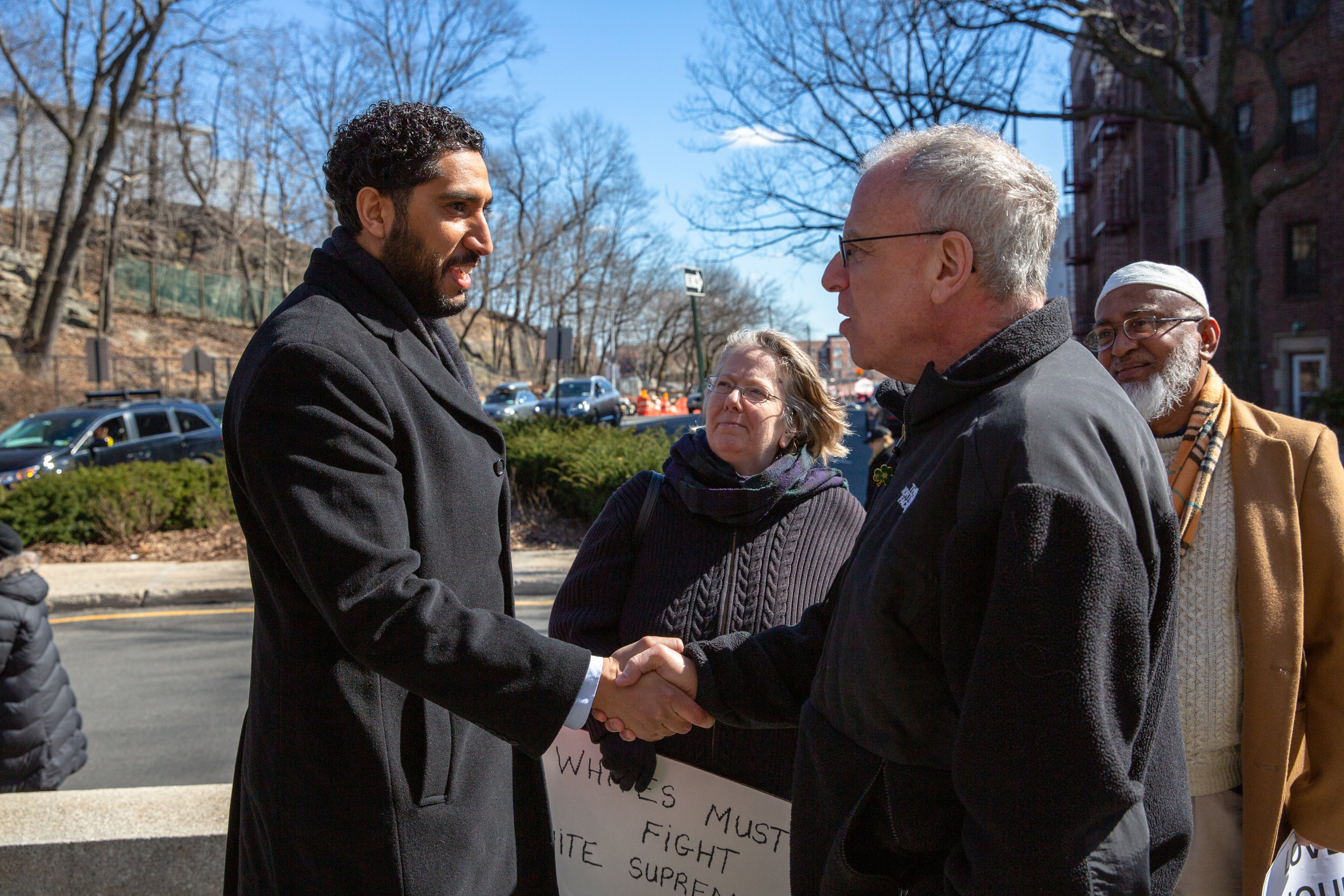 Yassine Taoufik, imam of the Abrar, shakes hands with Assemblyman Jeffrey Dinowitz at a vigil for the victims of the New Zealand massacre. Community members and religious leaders gathered at the Riverdale Monument to honor the memories of the 50 victims who died in a shooting rampage at two mosques in Christchurch on March 15.  Shot on assignment for The Riverdale Press .