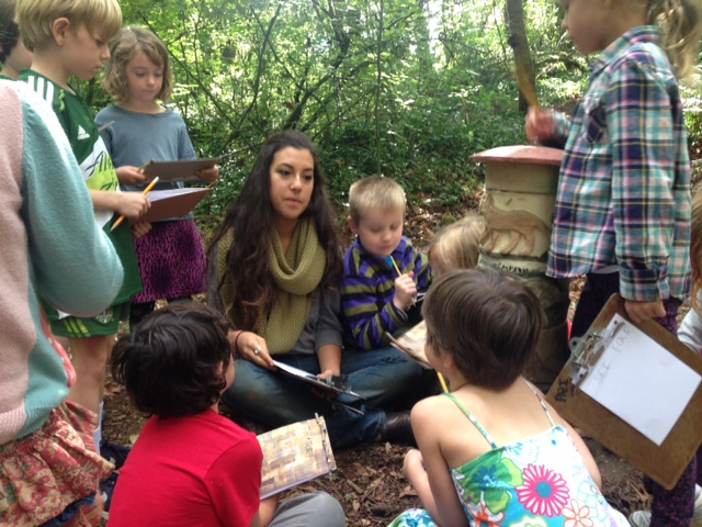Danielle with her scientists in the Arbor woods.