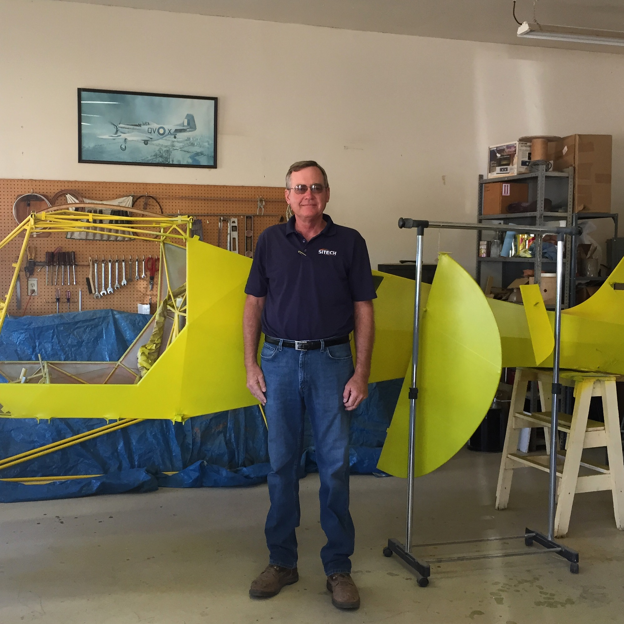 """Midland, TX. September, 2015.John Schoon of the local Experimental Aircraft Association (EAA) chapter in Midland stands in front of a plane the club is building. EAA was originally founded in 1953 by Paul H. Poberezny to bring aviation and the """"spirit of adventure"""" that comes with flying to the common man. """"There's nothing like the freedom of flight,"""" said Schoon. """"You can get from point A to point B however you wanna get there. It's just an awesome feeling,"""" he said, using the word in its true sense - inspiring awe, great admiration, and even fear. To experience true awesomeness is a humbling experience. """"To leave the ground instead of run around with all these cars crawling along. Just go above that. To see the clouds. To see a rain cloud dumping rain out and you're flying right beside it. Dip your wing in or fly over it. Fly around mountains, fly over Fort Davis. It's just a whole new freedom.""""  #Midland  #texas    #eaa    #aviation    #freedom  #SnapshotLives Link to article:  http://www.mrt.com/news/top_stories/article_43601078-6636-11e5-9365-238c278e6b24.html"""