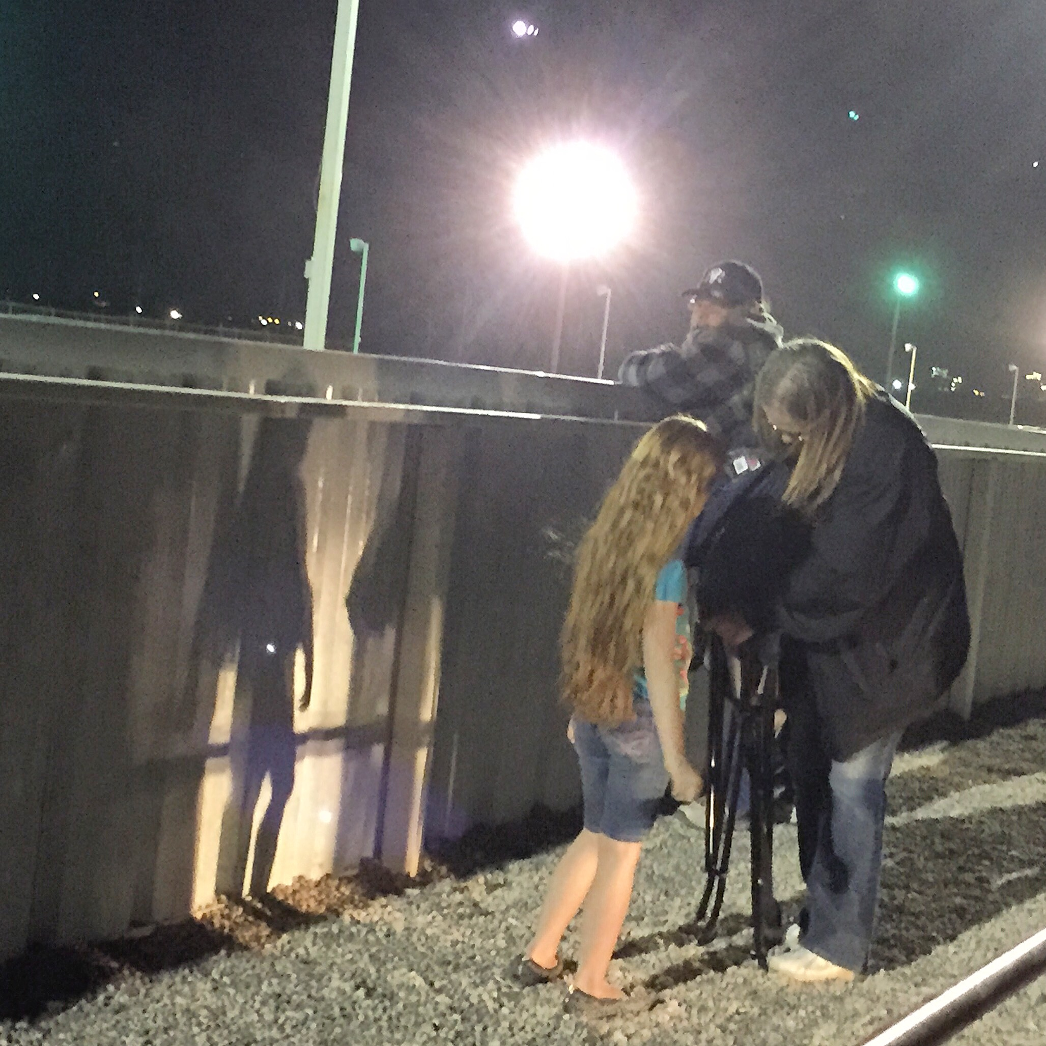 February, 2016. Penwell, TX. Friday night at the drag race. I loved this girl's long red hair...  #SnapshotLives  #dragrace    #odessa    #penwellraceway  #Texas