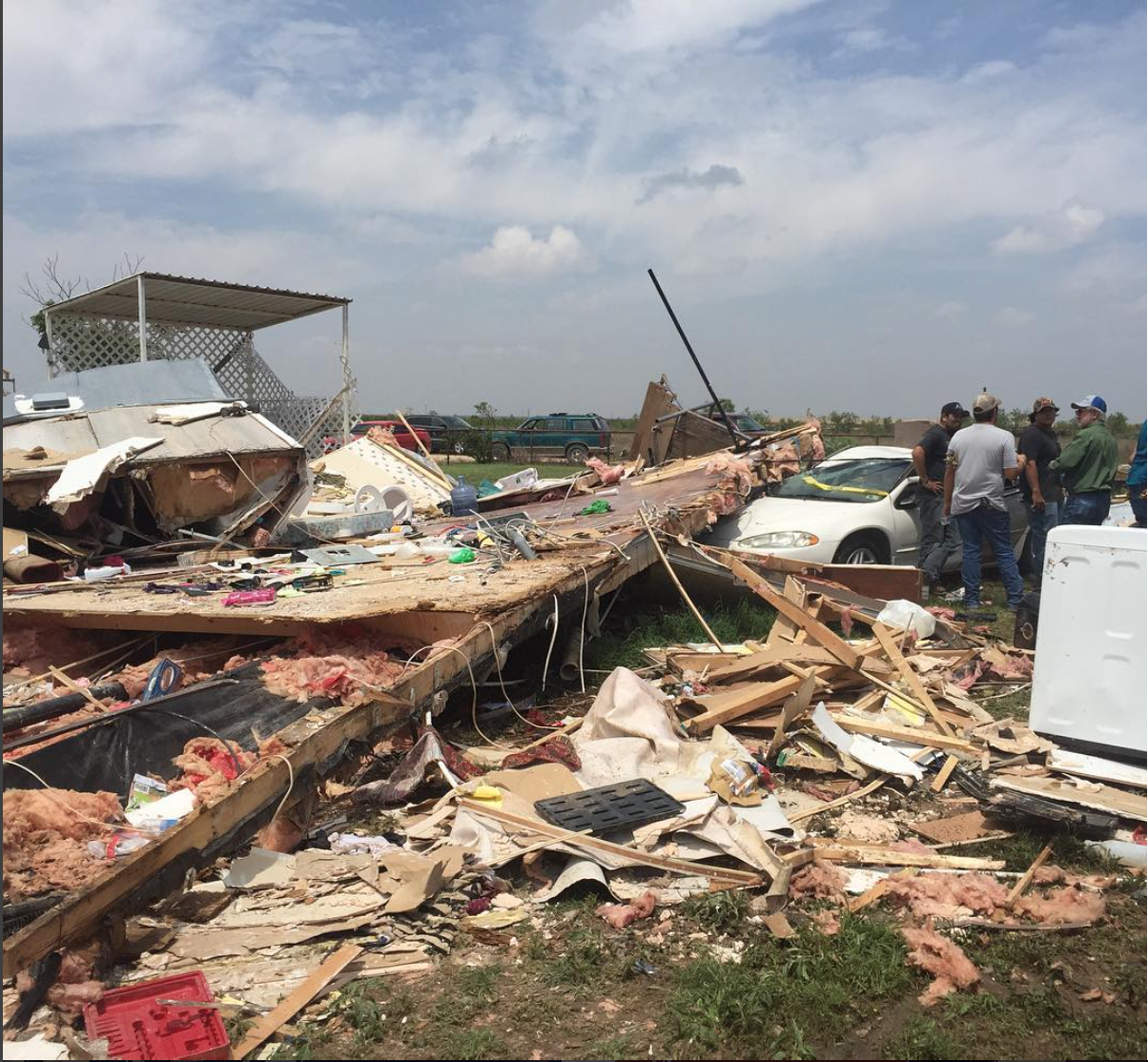 """Garden City, TX. The wreckage of Delia Pierson's mobile home after an EF4 tornado blew through Howard and Glasscock Counties on Sunday night. """"My mom lost everything I guess,"""" said Justin Pierson, Delia's son. """"This is her whole house with everything in it. But we found the important stuff, the family photos and everything like that. The rest, it's all stuff. It'll come back. Thank God nobody was hurt."""" Full story:  http://www.mrt.com/news/top_stories/article_f01b1d26-2157-11e6-a3b1-cbb13e4d2bf2.html   #gardencity  #glasscock  #howard  #bigspring  #texas  #tornado  #SnapshotLives"""