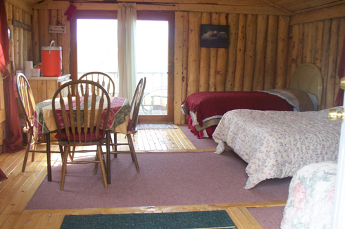 Inside the Loon Cabin          The Homestead Cabin also has a deck overlooking a small pond.   The Homestead has a Queen bed and a bunk bed.   wood heat